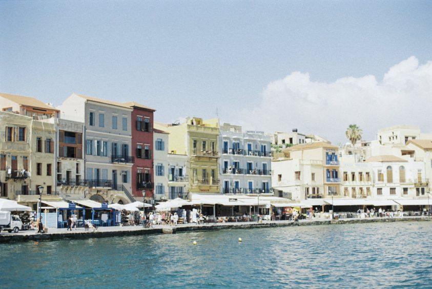 Greece Wedding in Chania, seaside view of buildings across the coast