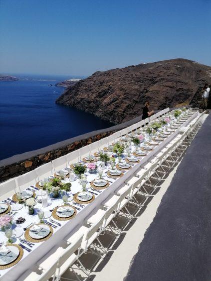 Art Catering dinnerware setup and sea view