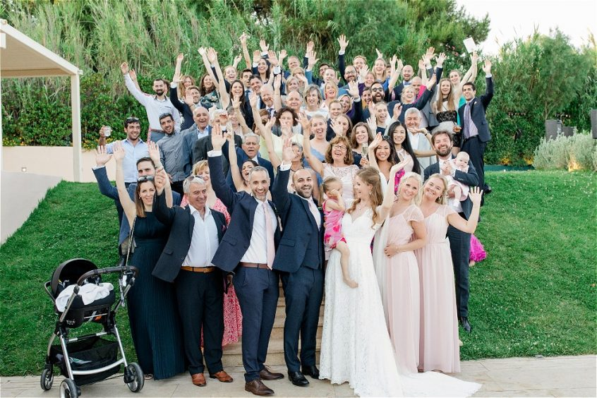 Couple and their guests at their wedding