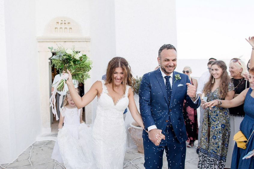 Couple after getting married in Greece at a church