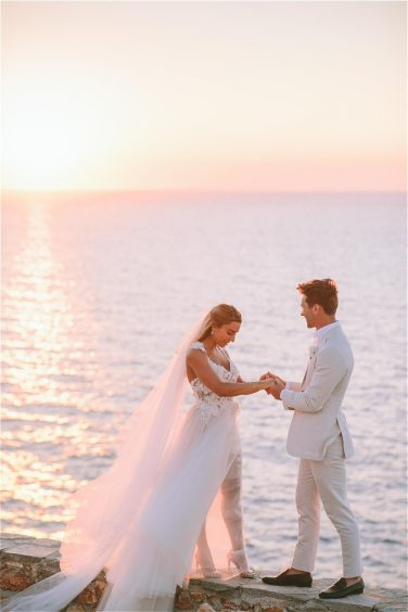 Couple getting married in Greece in front of sunset