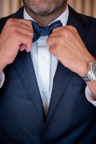 Closeup of groom wearing tuxedo
