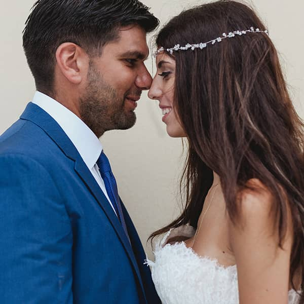 Where professionalism meets creativity: Boho bride with jewelled headpiece and groom with blue suit.