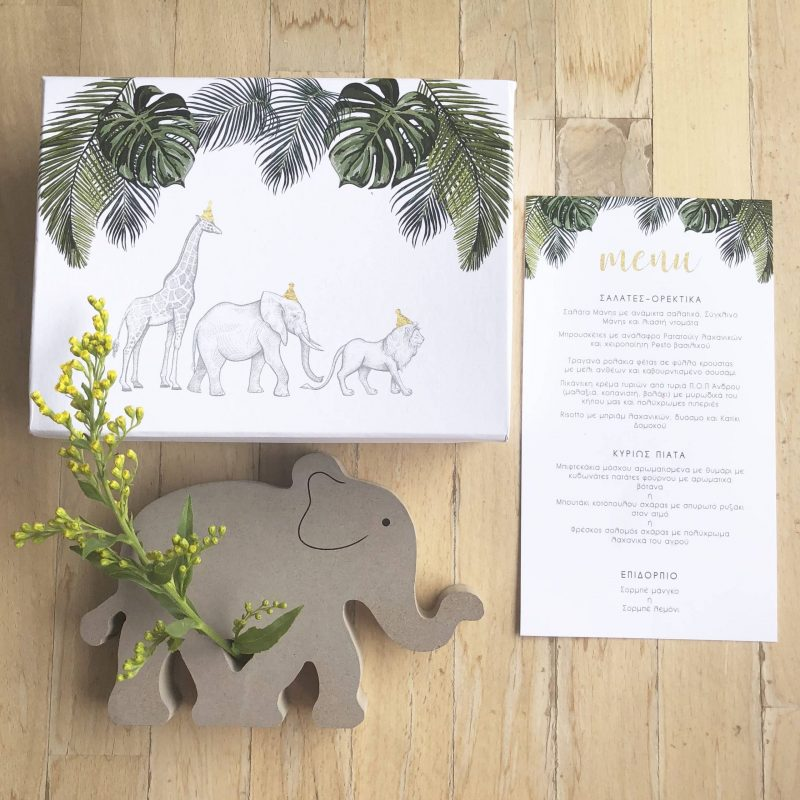 White Stories events: Jungle animals inspired menu and gift box and wooden elephant with flower.