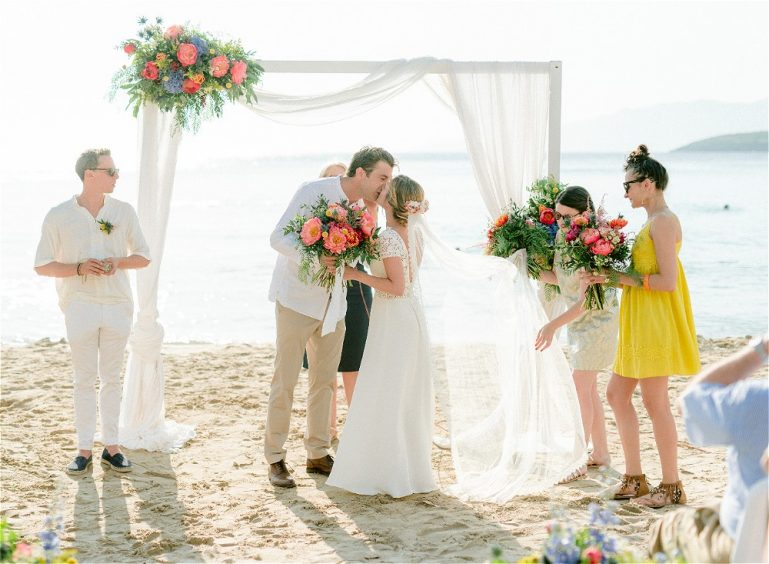 Couple getting married in Greece at a beach themed wedding