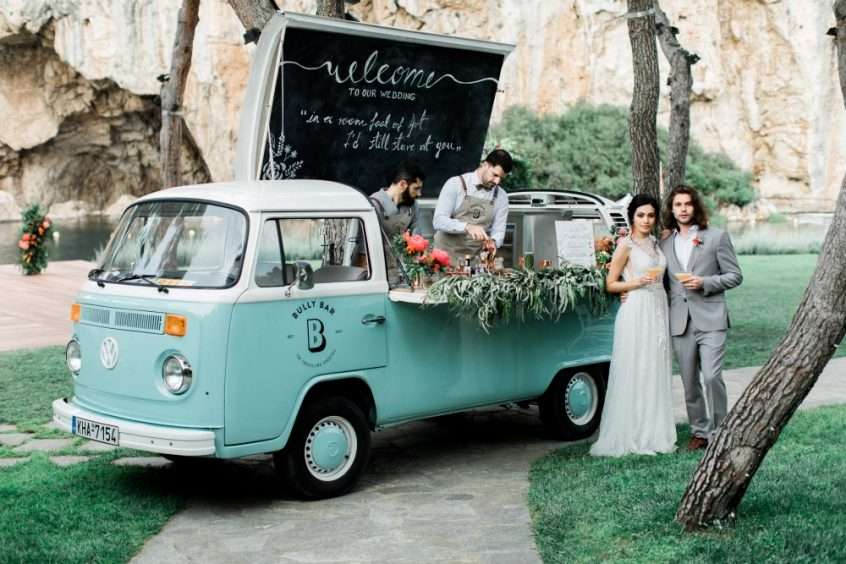 Bully bar management company in Greece in their van with wedding couple