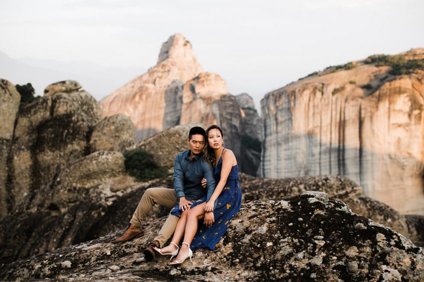 Couple at mountain side enjoying honeymoon after getting married in Greece