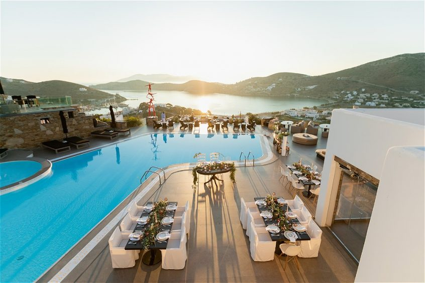View from height of pool and wedding tables at destination wedding in Ios